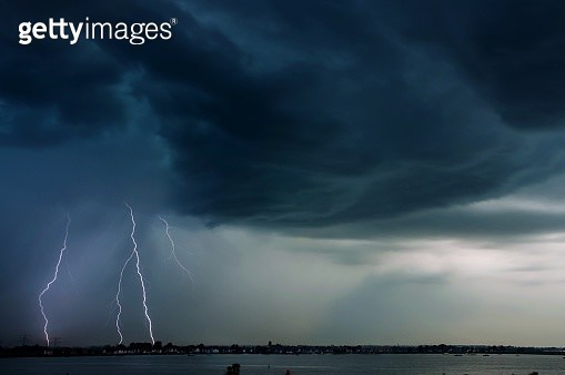 Scenic View Of Sea And Lightning Against Cloudy Sky - gettyimageskorea