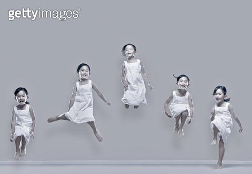 Girl jumping in air - gettyimageskorea