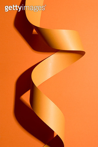 Orange Colored Paper Stripe Curl on Orange Colored Background Directly Above View. - gettyimageskorea