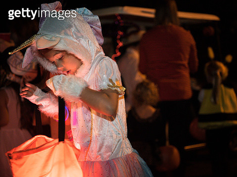 Young girl is trick-or-treating at Halloween - gettyimageskorea