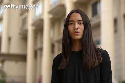 Portrait Of Beautiful Young Woman Standing Outdoors - gettyimageskorea