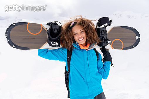 Portrait of a happy snowboarder - gettyimageskorea