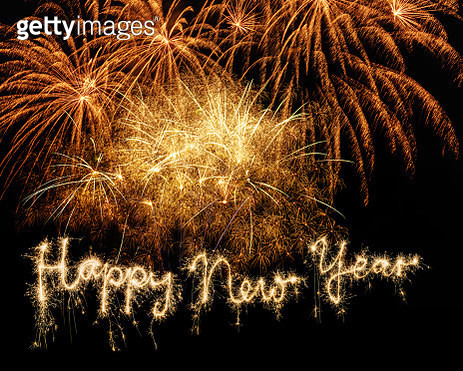 Sparkler Happy New Year with Fireworks on Sky - gettyimageskorea