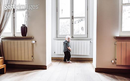 little kid walking alone at home - gettyimageskorea