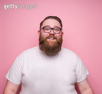 Large bearded man on pink background - gettyimageskorea