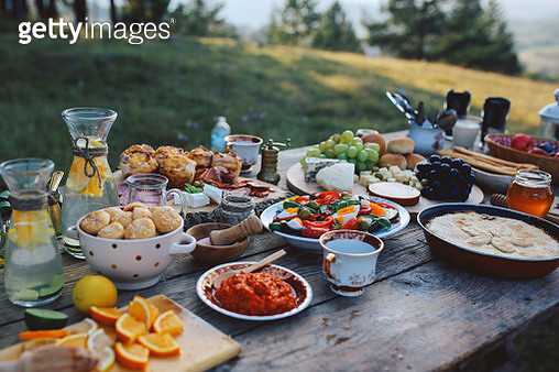 Food for picnic day in the countryside. Various foods on an old, rustic, wooden table. - gettyimageskorea