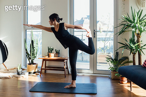 Young woman doing yoga exercise at home - gettyimageskorea