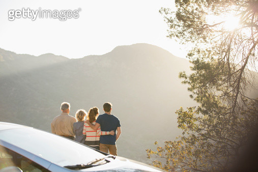 Family looking at mountain view outside car - gettyimageskorea