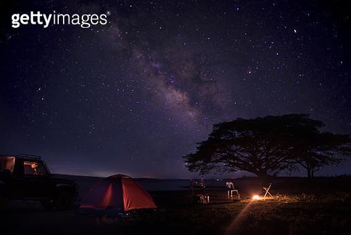 Illuminated Tent On Field Against Sky At Night - gettyimageskorea
