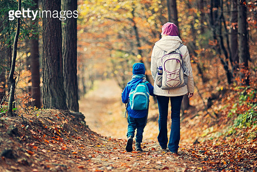 Mother and son hiking in autumn forest - gettyimageskorea