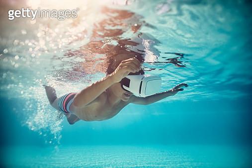 Little boy swimming in Virtual Reality - gettyimageskorea