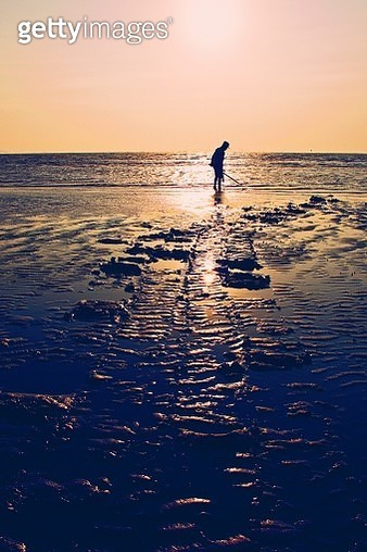 Silhouette Fisherman standing on Beach Against Sky During Sunset, Thailand - gettyimageskorea