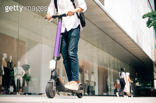 Young Businessman Using Electric Scooter to Work - gettyimageskorea