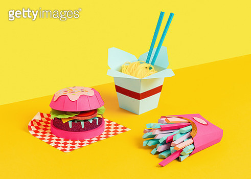 Studio still life image of a paper crafted burger, fries and noodles shot on yellow background. - gettyimageskorea