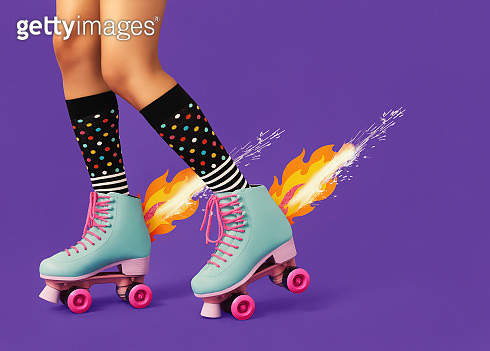 Studio shot of woman rollerskating with flames coming out of the skates. - gettyimageskorea