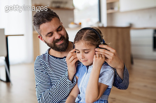 Small girl with father listening to music. - gettyimageskorea