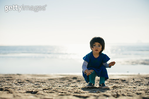 Portrait of an adorable little girl beachcombing in winter - gettyimageskorea