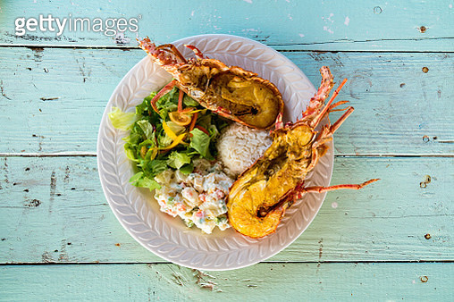 Dish with fresh lobster, rice and vegetables, Caribbean - gettyimageskorea