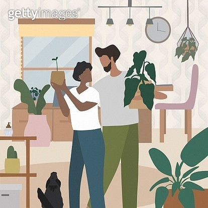 Beautiful couple take care of plants. - gettyimageskorea