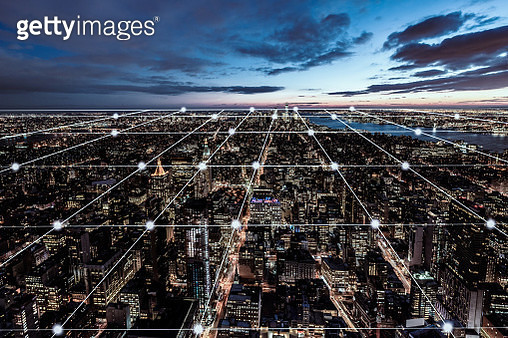 Blockchain Concept and Manhattan Skyline at Night - gettyimageskorea