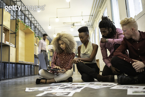 Business team discussing some papers on the floor in the office - gettyimageskorea