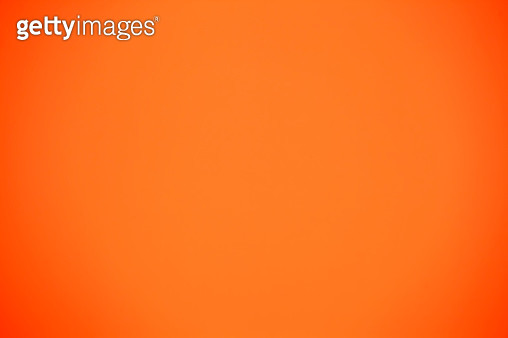 Shot Of Orange Colored Paper Background - gettyimageskorea