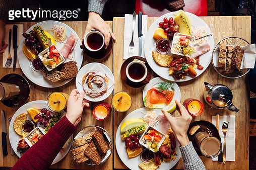 Group of friends having celebration dinner together, directly above view - gettyimageskorea