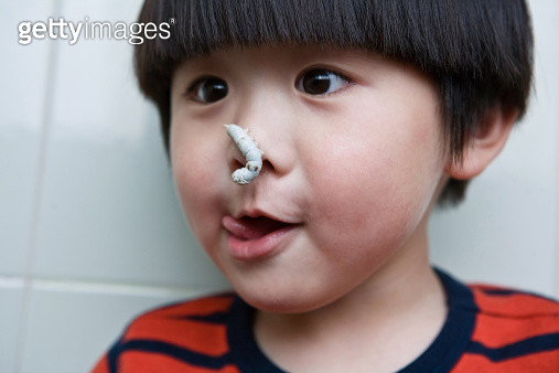 A little boy with silkworm on his nose - gettyimageskorea