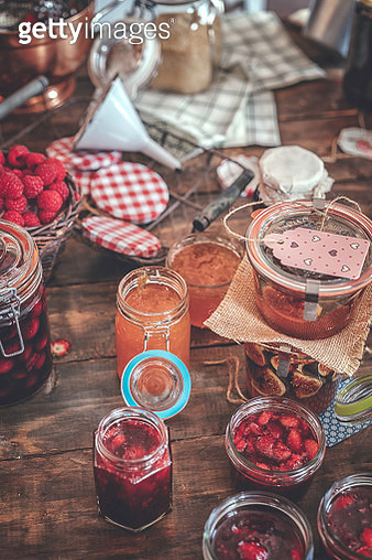 Preparing Homemade Strawberry, Blueberry and Raspberry Jam and Canning in Jars - gettyimageskorea