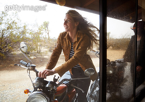 Young woman getting ready for motorcycle ride - gettyimageskorea
