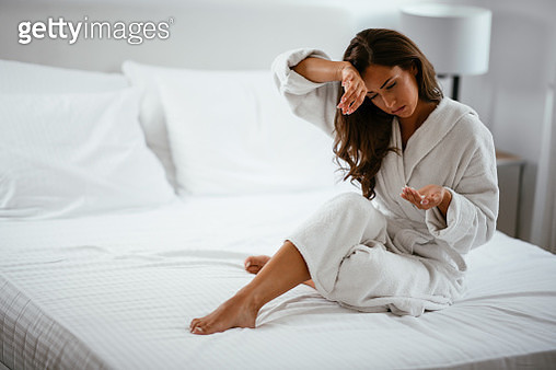 Woman with a stomach ache - gettyimageskorea