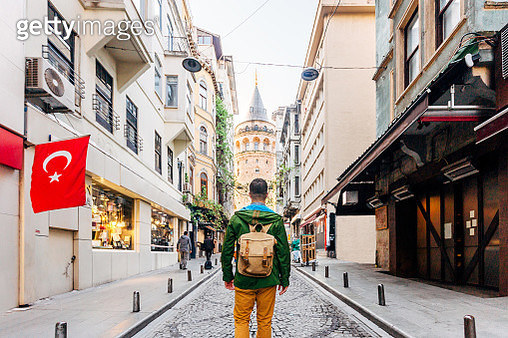 Tourist with backpack looking at Galata tower, Istanbul, Turkey - gettyimageskorea