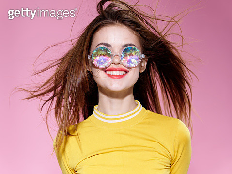 A young girl with flying hair smiles broadly. - gettyimageskorea