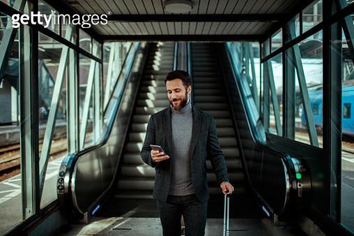 Businessman using a phone - gettyimageskorea