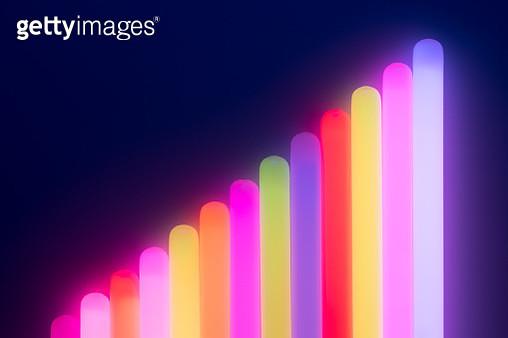 Bar Graph Shape Illuminated Glow Sticks Against Dark Blue Background. - gettyimageskorea