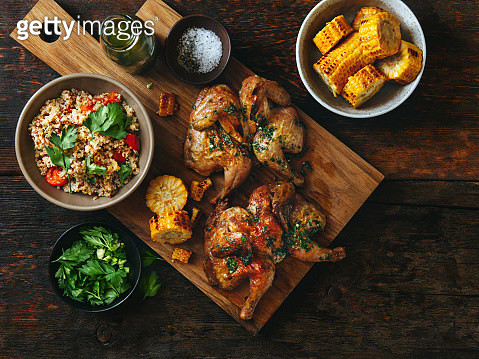 Grilled whole butterflied chickens - gettyimageskorea