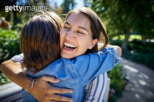 Happy senior woman and her adult daughter hugging in a park - gettyimageskorea