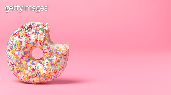 Doughnut on pink with bite out - gettyimageskorea