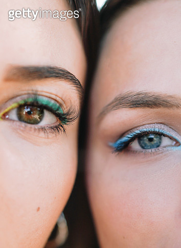 Close up portrait of two caucasian women with colourful eyemakeup,Spain - gettyimageskorea