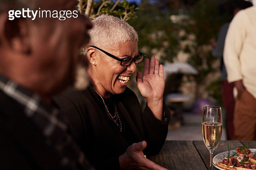 Mature woman enjoying party at home - gettyimageskorea