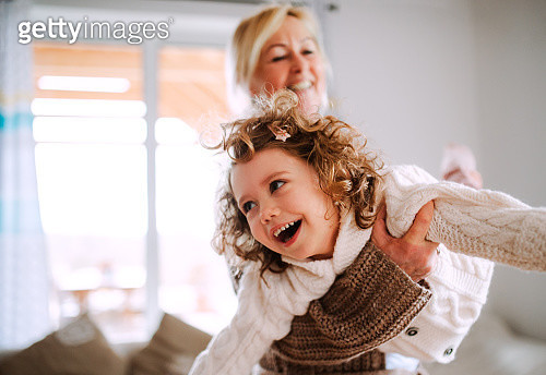 A Portrait Of Small Girl With Grandmother Having Fun At Home - gettyimageskorea
