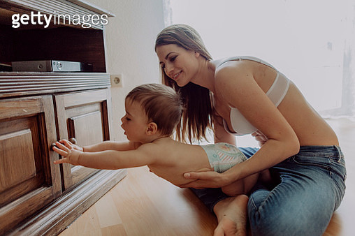 Mother and baby son playing at home - gettyimageskorea