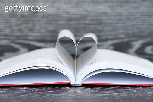 Heart Shape Made With Pages Of Book On Wooden Table - gettyimageskorea