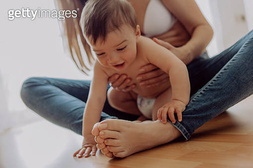 Mother cuddling and playing with her baby son - gettyimageskorea