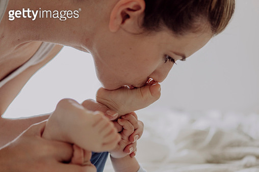 Mother cuddling with her baby son - gettyimageskorea