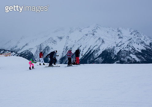 People Skiing On Snowcapped Mountain Against Sky - gettyimageskorea