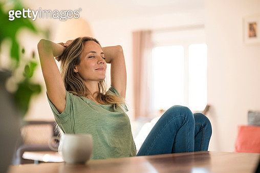 Woman sitting at dining table at home relaxing - gettyimageskorea