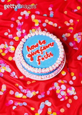 Cake with writing on it on red table cloth with confetti. - gettyimageskorea