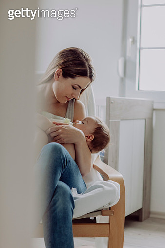 Mother feeding her baby son - gettyimageskorea