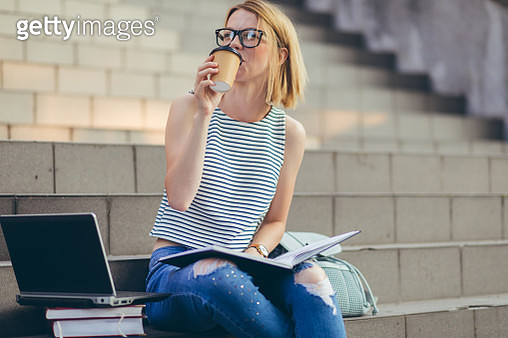 Student girl takes coffee break - gettyimageskorea